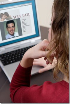 Young woman using internet dating service