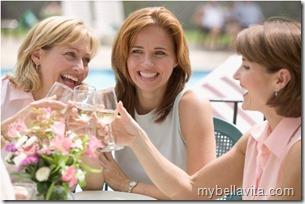 Women Toasting Wine Glasses --- Image by © Royalty-Free/Corbis