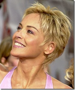 "LOS ANGELES, CA June 5, 2004 (SSI) - - Actress Sharon Stone poses for photographers, during the ""2004 MTV Movie Awards"" on June 5, 2004, in Los Angeles. Michael Germana/ Super Star Images"